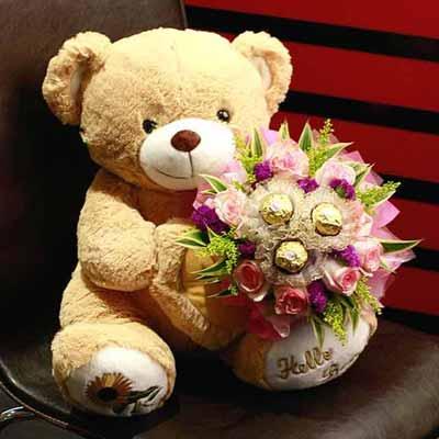 oso de peluche con flores